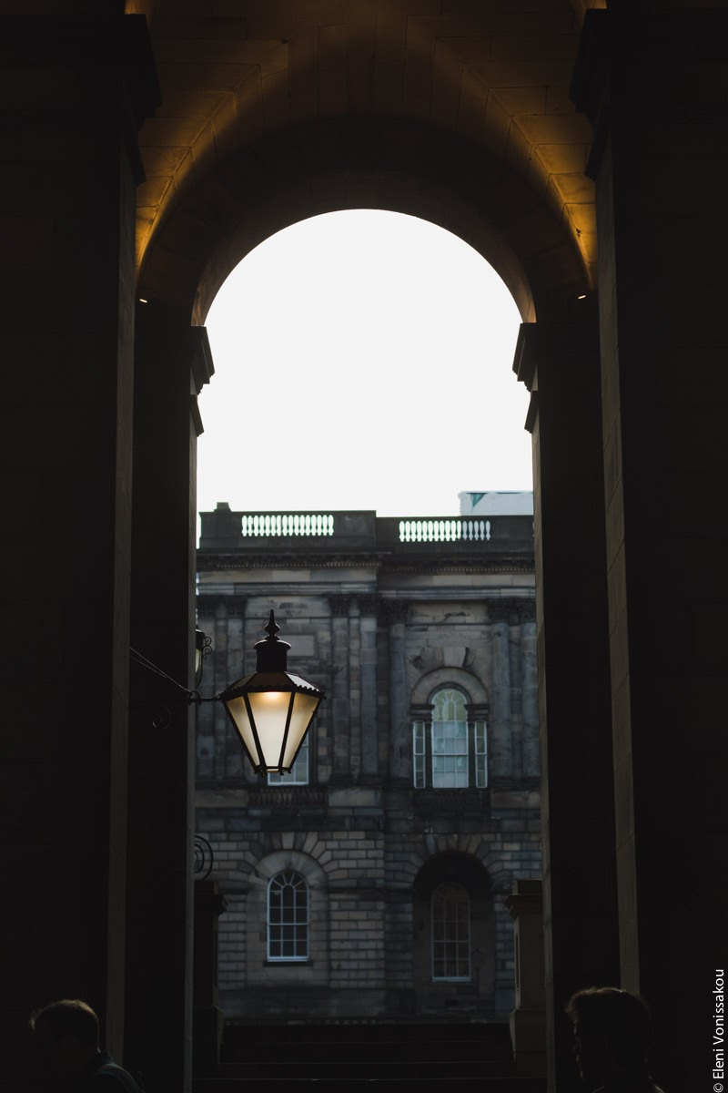Butternut Squash Soup with Chilli and Whipped Goat's Yoghurt Feta www.thefoodiecorner.gr Photo description: A dark view through an archway looking into a courtyard with old university buildings.