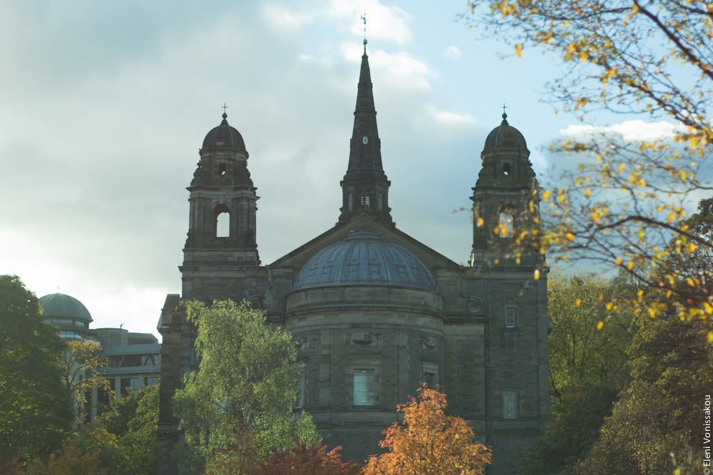Butternut Squash Soup with Chilli and Whipped Goat's Yoghurt Feta www.thefoodiecorner.gr Photo description: A church under a hazy blue grey sky, trees with autumn leaves in front of it (St. Cuthbert's in Princes Street Gardens)