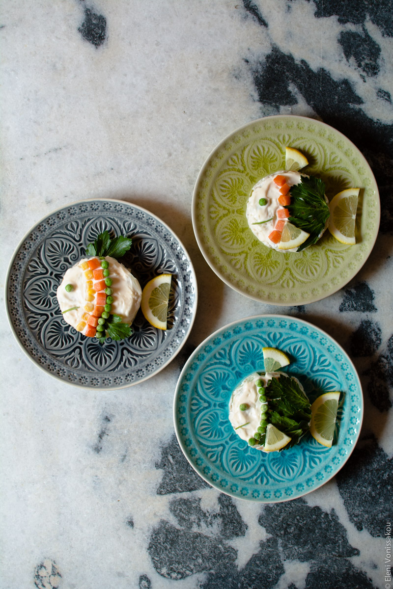 """Retro Fish Salad with Mayonnaise, aka """"Athinaiki"""" www.thefoodiecorner.gr Photo description: The three plates described in the featured photo, only arranged closer together in the centre of the photo. They are all sitting on the white and grey marble surface."""