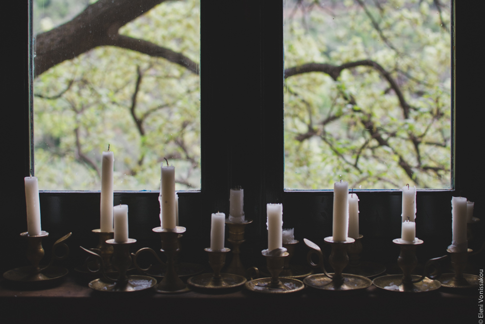 Milia Workshop 2017 – A long overdue recap. Part 1. www.thefoodiecorner.gr - Photo description: Old fashioned candlesticks with handles sitting in a row on a windowsill. The white candles are half burnt. Behind them the branches of a tree are visible through the window.