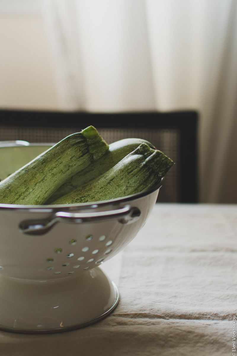 """Courgette (Zucchini) Boats with Chicken and Greek Yoghurt """"Bechamel"""" www.thefoodiecorner.gr Photo description: A side view of a metal colander containing three courgettes, the tops of which are visible."""
