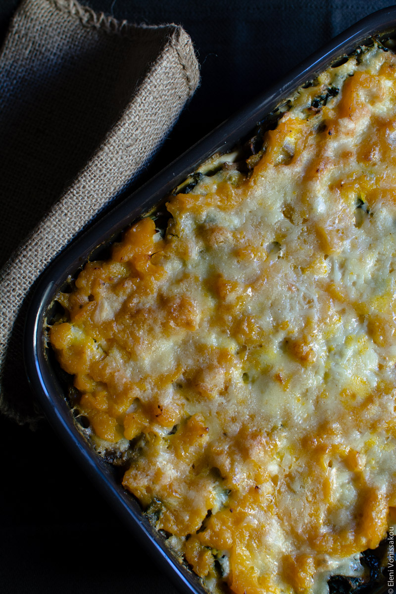 Cottage Cheese Vegetable Lasagne with Butternut Squash, Spinach and Mushrooms www.thefoodiecorner.gr Photo description: A closer view of the surface of the cooked lasagna, with the butternut squash puree oozing up from under the browned melted cheese.