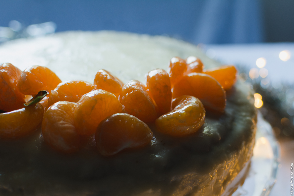 Greek New Year's Cake (Vassilopita) with Mandarin, Almonds and Cardamom www.thefoodiecorner.gr Photo description: Another close view of the top of the cake, from the other side, with the light illuminating the mandarin segments.