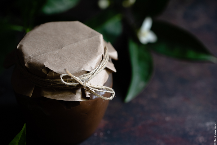 Chocolate Orange Curd – The Easy Way www.thefoodiecorner.gr Photo description: A close view of the top part of a jar with chocolate orange curd, the lid covered with paper and tied with string.
