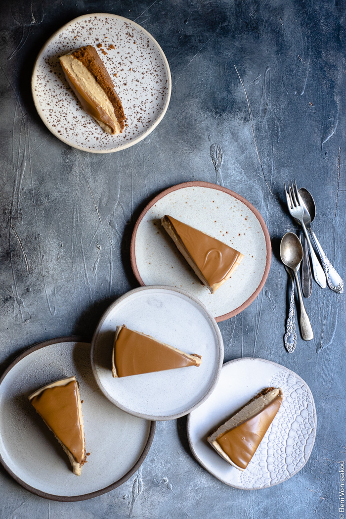 Easy Speculoos Cheesecake www.thefoodiecorner.gr Photo description: five ceramic plates each with a piece of cheescake on it. One plate is stacked on some of the others forming a small cluster.