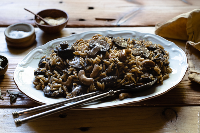 Plant-Based Slow Cooker Balsamic Mushroom Orzotto with Cashews and Sage www.thefoodiecorner.gr photo description: A close, side view of a large platter with balsamic mushroom orzotto.