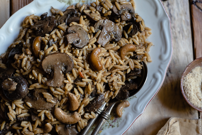 Plant-Based Slow Cooker Balsamic Mushroom Orzotto with Cashews and Sage www.thefoodiecorner.gr photo description: A close view of mushroom orzotto, the sliced mushrooms, cashews and orzo grains clearly visible.