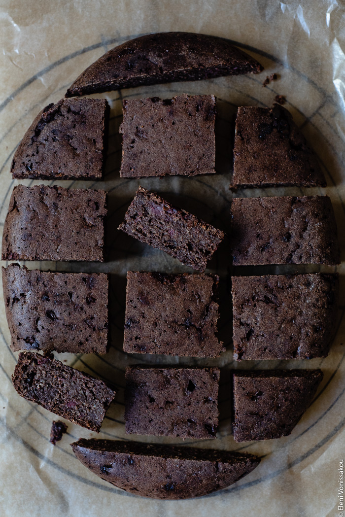 Plant-Based, Date-Sweetened Chocolate Banana Oat Cake-Bars, in the Slow Cooker www.thefoodiecorner.gr Photo description: A close view of Chocolate Banana Oat Cake-Bars cut up and arranged (in the shape of the slow cooker) on a piece of grease-proof paper.