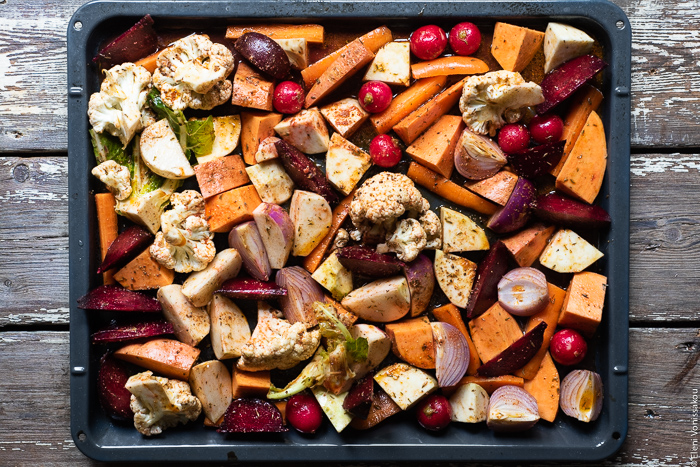 "Cumin Roasted Root Vegetable Medley. My Winter ""Briam"". www.thefoodiecorner.gr Photo description: Raw, chopped root vegetables and cauliflower spread out on a baking dish ready to be roasted."