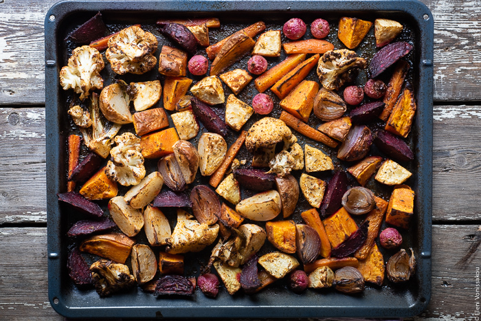 "Cumin Roasted Root Vegetable Medley. My Winter ""Briam"". www.thefoodiecorner.gr Photo description: Roasted root vegetables and cauliflower spread out on a baking dish ready to be served."