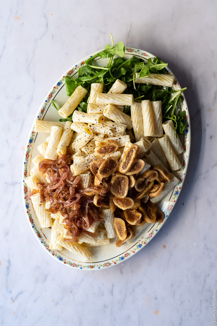 Caramelised Onion, Fig and Fresh Cheese Pasta with Arugula www.thefoodiecorner.gr Photo description: a platter with the elements of the dish before being tossed together.
